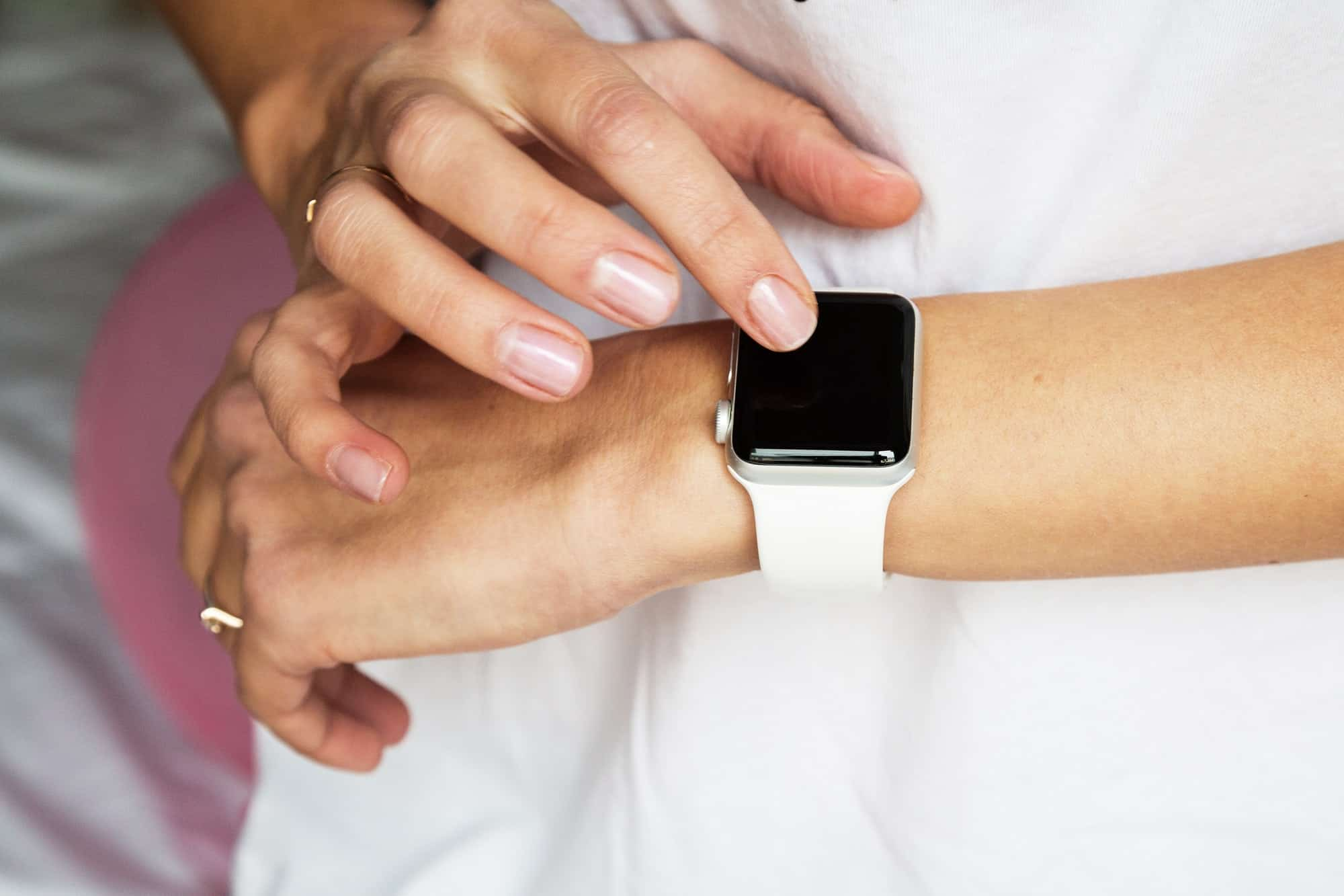 Closeup photo of Woman hands with manicure using smart apple watches