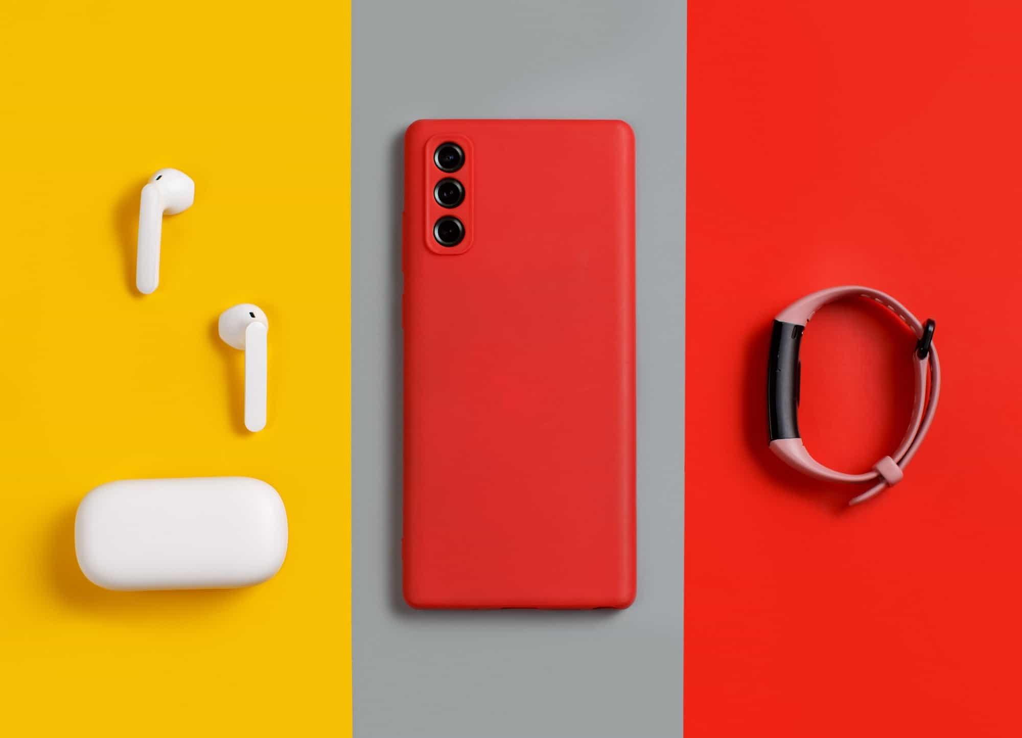 Smartphone, white wireless earphones and smart watch